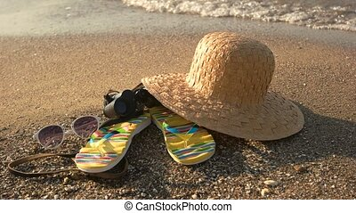 Beach hat on sand. Black vintage binoculars. New horizons...