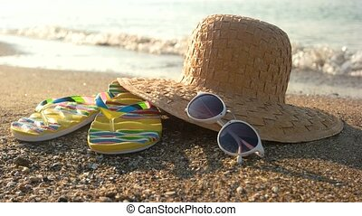 Hat and flip flops, seashore. Sand and sunglasses. Get ready...