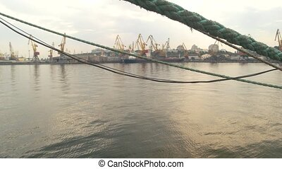 Vessel on port background. Ship nose and ropes. Maritime and...