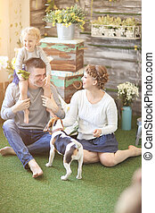 happy family and pet dog on the background of country house...