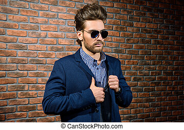 forceful and stylish - Portrait of a well-dressed imposing...