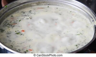 Cheese soup with herbs cooked in pan - Cheese soup with...