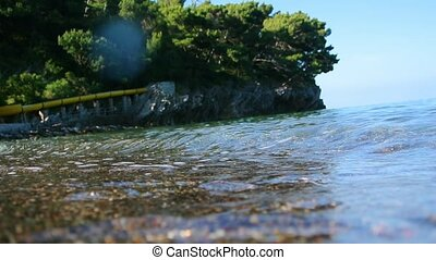 Underwater photography, you can see the beach. The sea coast...