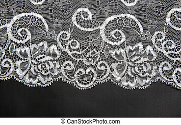 Decorative white lace on insulated black background