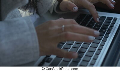 Crop shot of woman using laptop