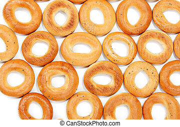 Tasty bagels put in the manner of background on white sheet