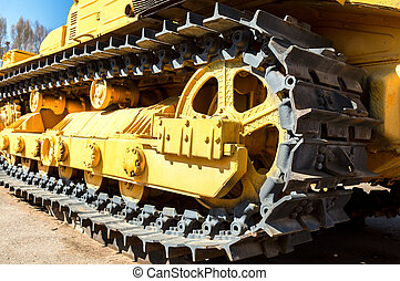 Heavy construction bulldozer. Closeup old caterpillar...