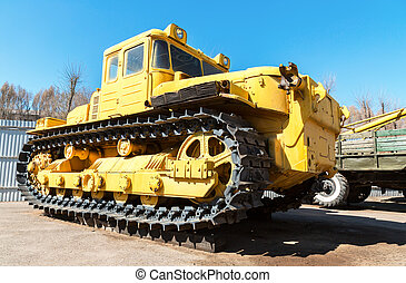 Heavy yellow construction bulldozer. Closeup view of old...
