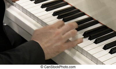 The hands of a classical pianist on the piano. Close-up. -...