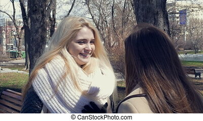 Two beautiful sexy girls, blond and brunette - talking in...
