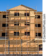 Building Construction - The front of a new building during...