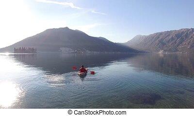 Kayaks in the lake. Tourists kayaking on the Bay of Kotor,...