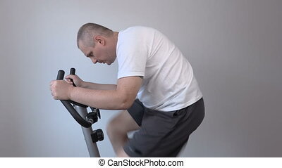 Man using exercise bike very fast