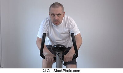 Man using exercise bike