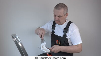 Worker with spatula near wall