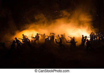 War Concept. Military silhouettes fighting scene on war fog sky background, World War Soldiers Silhouettes Below Cloudy Skyline At night. Attack scene. Armored vehicles.