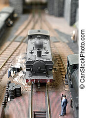model steam train in a station siding