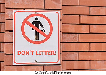 Don't litter sign - Do not litter sign on brick wall