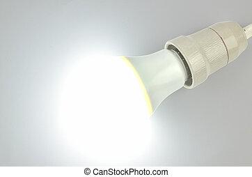 Lit LED light bulb on white