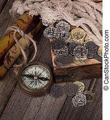 Gold and Silver Coins - Gold and silver coins in a treaure...