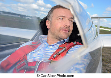 Man in glider looking over his shoulder