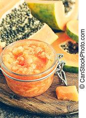 Fresh papaya natural facial mask peeling puree in glass jar...
