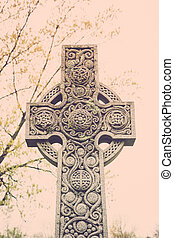 Celtic Cross Tombstone - A Celtic cross tombstone with...