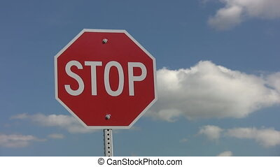 Stop sign. Timelapse clouds. - Stop sign with fluffy...