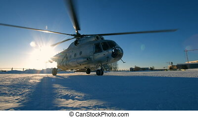 Mi-8 helicopter during the parking, spinning blades. snowy...