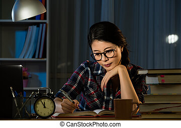 Serious asian young student studying