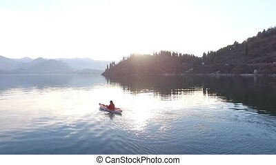 Kayak on Lake Skadar in Montenegro. Tourist kayaking. Aerial...