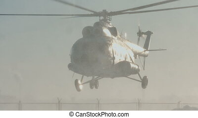 The Mi-8 helicopter is landing, the blades are spinning....