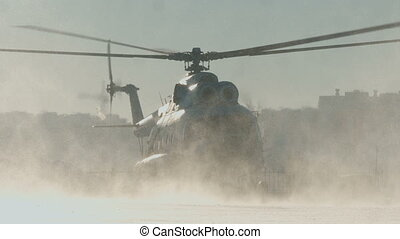 The Mi-8 helicopter takes off, the blades spin. snowy...