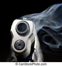Smoking gun - Blue smoke that is rising from the muzzle of a...