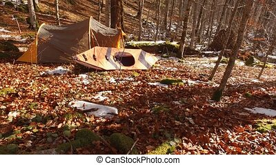 Tent and kayak in the forest. Winter forest in Montenegro,...