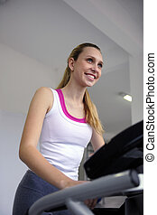 woman on treadmill at the gym working out