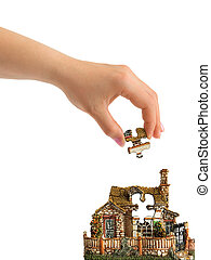 Hand and puzzle house
