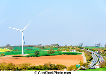 Wind Turbines and Blue Sky with Clouds over UK fields