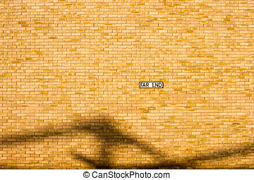 Brick wall background street name sign on it.