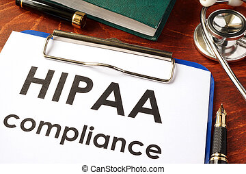 HIPAA compliance form on a clipboard. Medical privacy...
