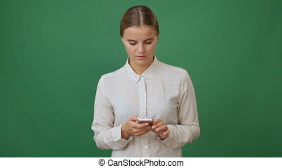Young woman holding a smartphone and making a call