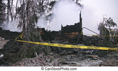 Winter house fire - Smouldering remains of a house fire Two...