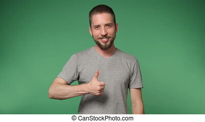 hipster man in a gray shirt  showing thumb up