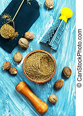 nutmeg and powder in bowl and on a table