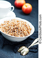 buckwheat - boiled buckwheat in bowl and on a table