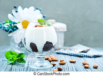desert with cream and dry almond in glass