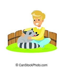 Happy little boy sitting on green grass and petting raccoon...