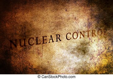 Nuclear control text on grunge background