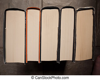 Bookstack - Stack of hardback books from a high angled view