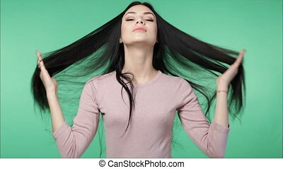 woman playing with long beautiful hair